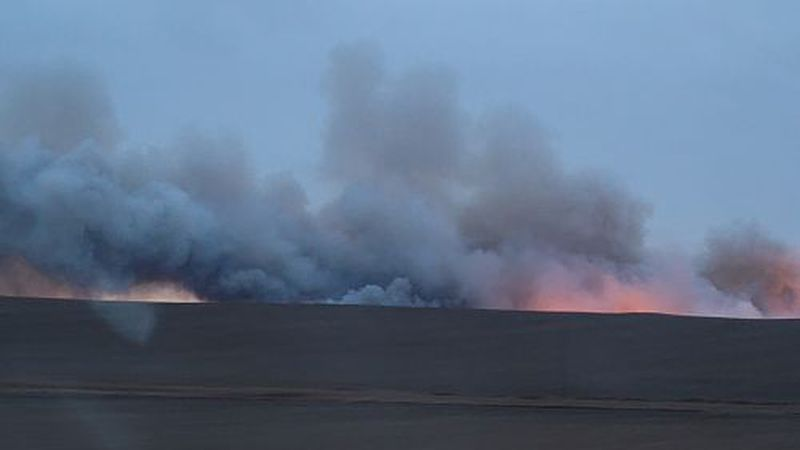 Smoke billows from a large wildfire near Lemmon.