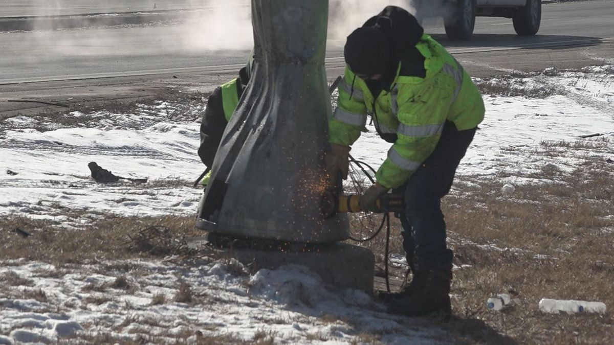 Crews are working hard to fix the traffic light pole. (KOTA)