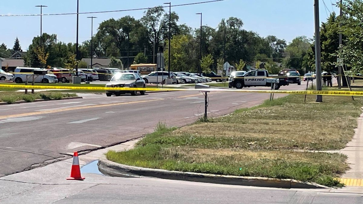 Caution tape blocks off part of North Maple Avenue as police investigate the circumstances...