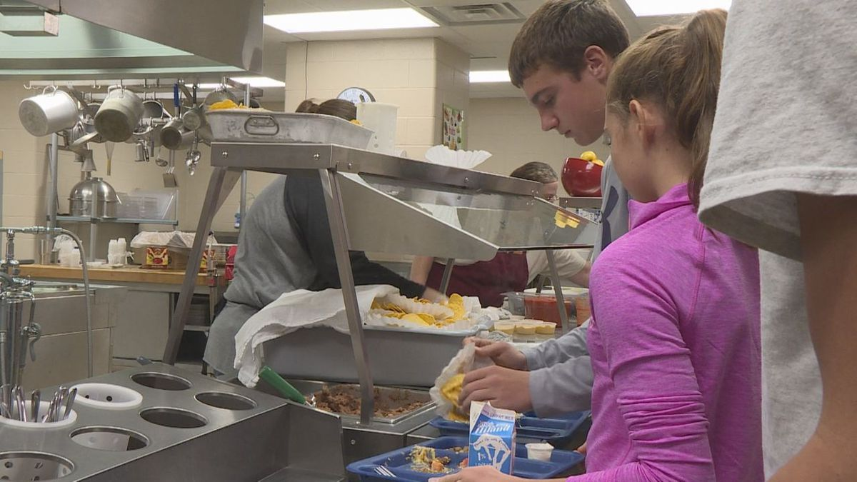 Students at Wall School get their school lunches. Today, the menu was nachos.