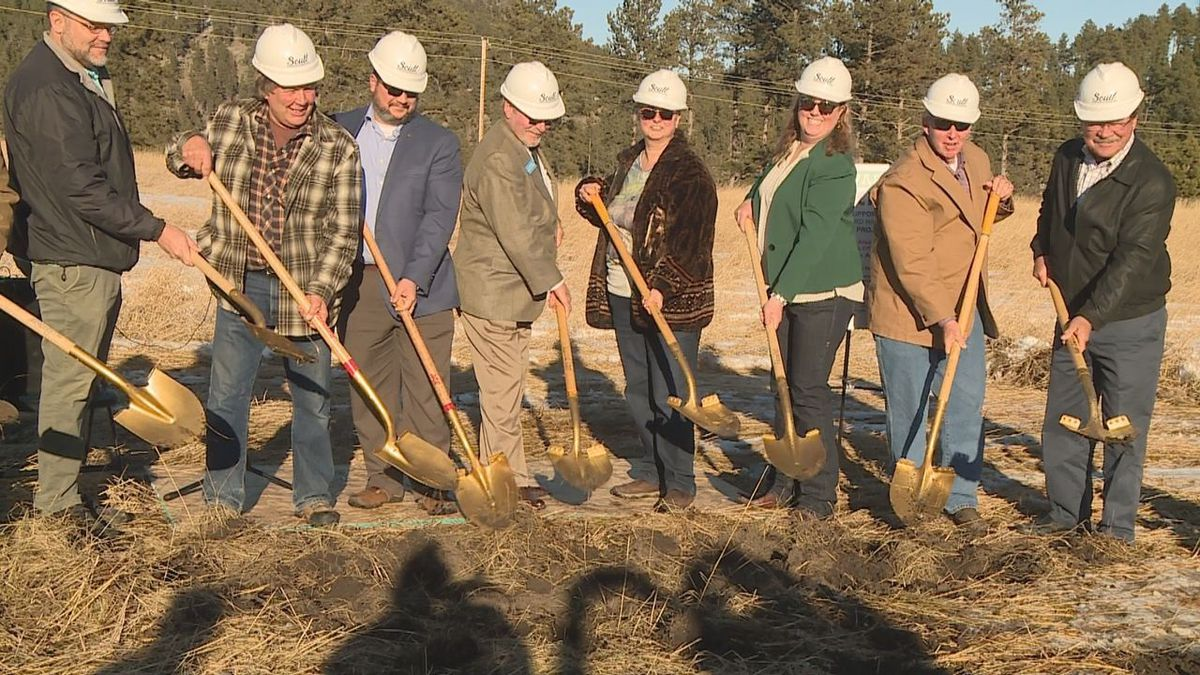 Community members break ground on the new Forward Hill City Housing Project.