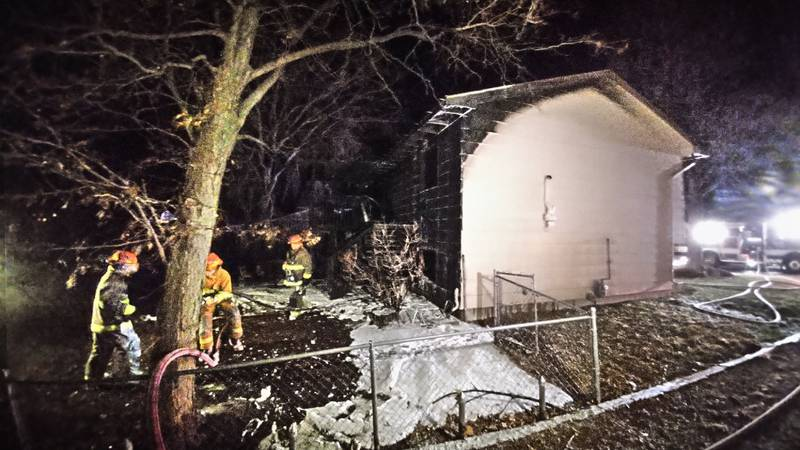 Multiple fire agencies survey the damage done to a Rapid Valley home after an overnight fire...
