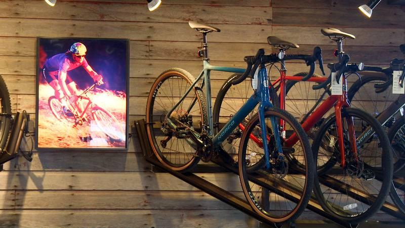 Road bicycles hang for display for a customer's consideration at Black Hills Bicycles on Feb....