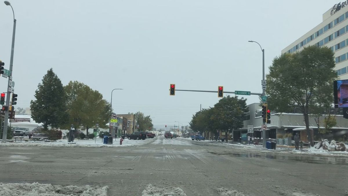 The intersection of Mt. Rushmore Road and Main Street in Rapid City sees the first snow of the year.