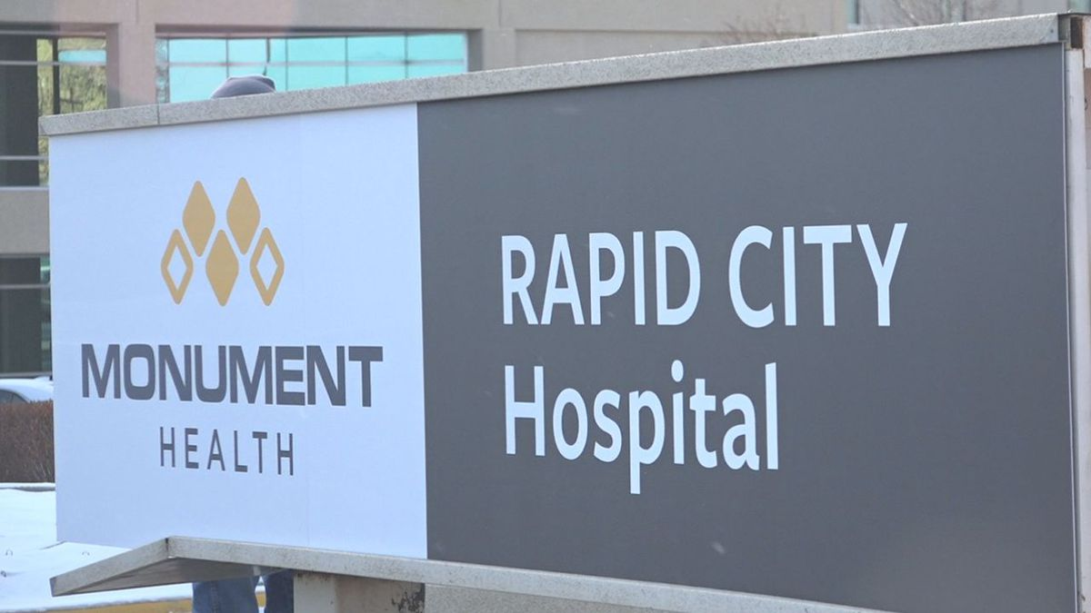 A new 'Monument Health' sign is installed on Wednesday as part of the re-branding process for the Rapid City Regional Hospital. (KOTA)