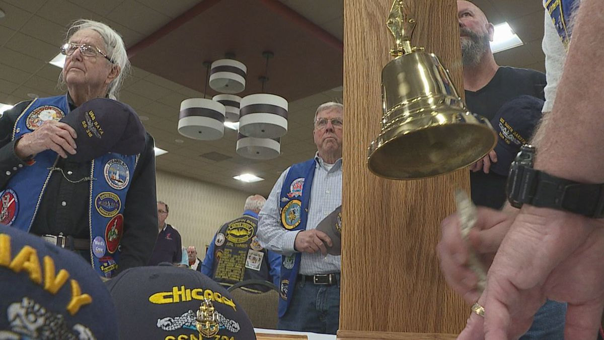 Submariner rings the bell in a ceremony for submariners who died while serving the United States at the Ramkota Hotel in Rapid City on May 18, 2019. (KOTA TV)
