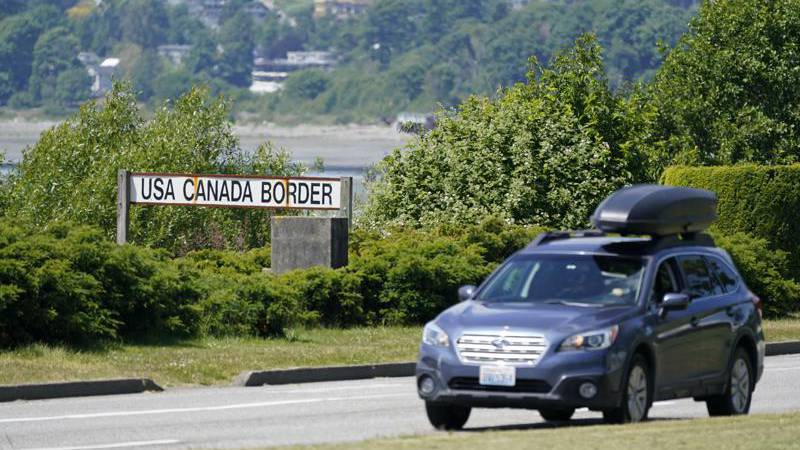 In this June 8, 2021, file photo, a car heads into the U.S. from Canada at the Peace Arch...