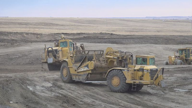 Machines leveling the land.