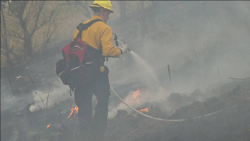 Firefighters fend off the flames