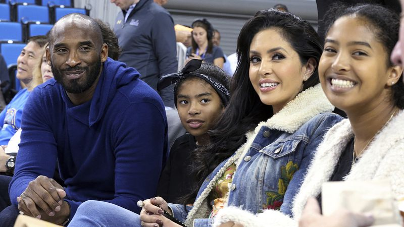 FILE - In this Nov. 21, 2017, file photo, from left, Los Angeles Lakers legend Kobe Bryant, his...