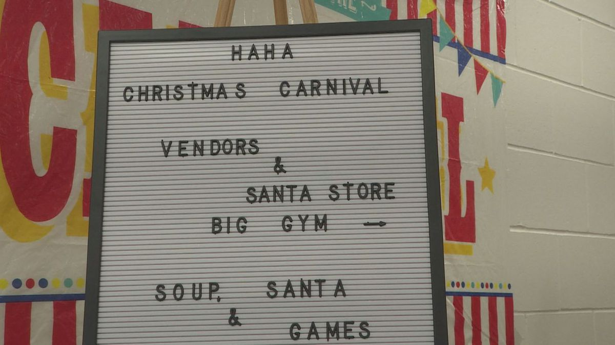 Families bond over a Christmas carnival.