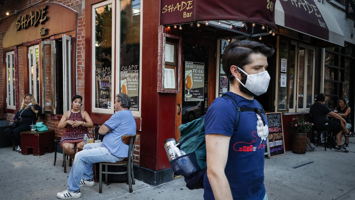 Customers dine outside Shade Bar NYC, Monday, June 22, 2020, in New York. New York City ventured into a crucial stage of reopening as stores let people in Monday, offices brought workers back, restaurants seated customers outdoors and residents both welcomed and worried about rebounding from the nation�s deadliest coronavirus outbreak. (AP Photo/John Minchillo)