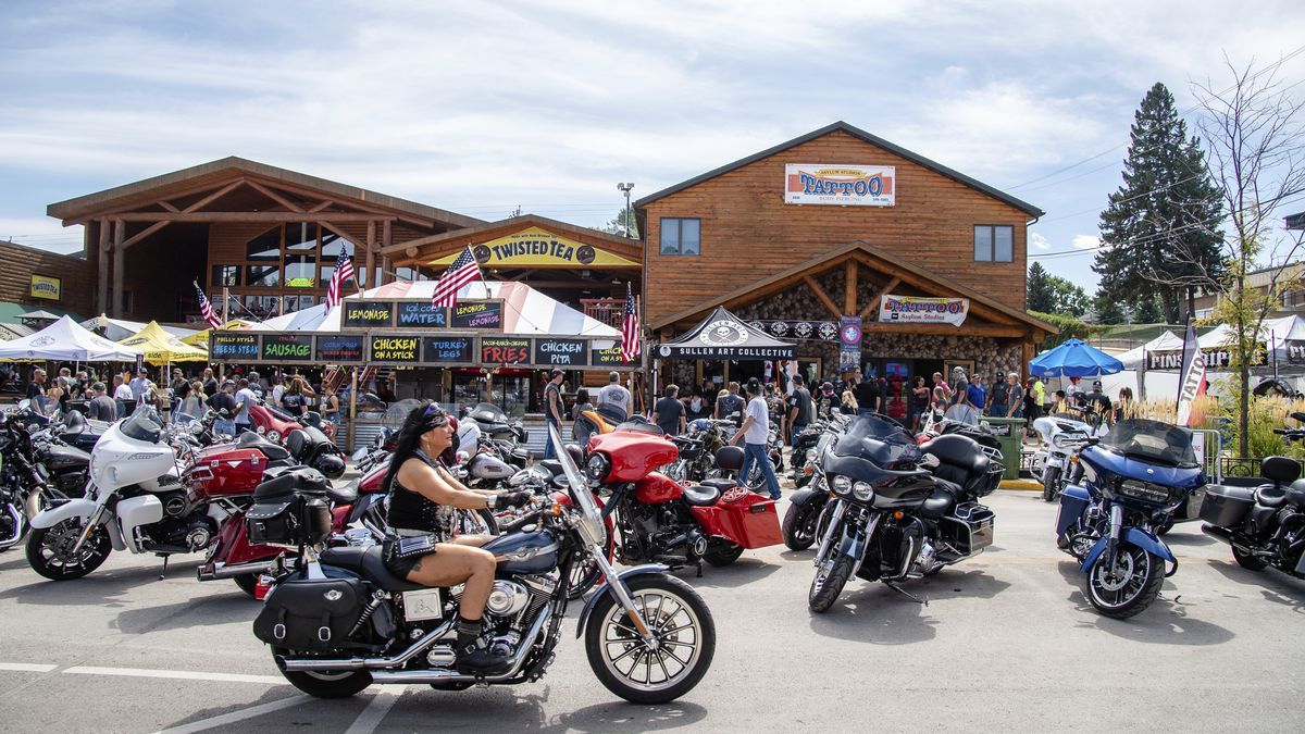 A biker rides down Main Street during the 80th annual Sturgis Motorcycle Rally on Saturday,...
