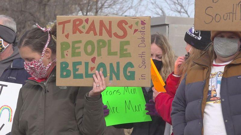 "Signs that says ""Trans people belong in South Dakota."""