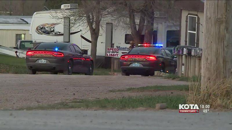New Video: Law Enforcement officers surround mobile home park, man arrested