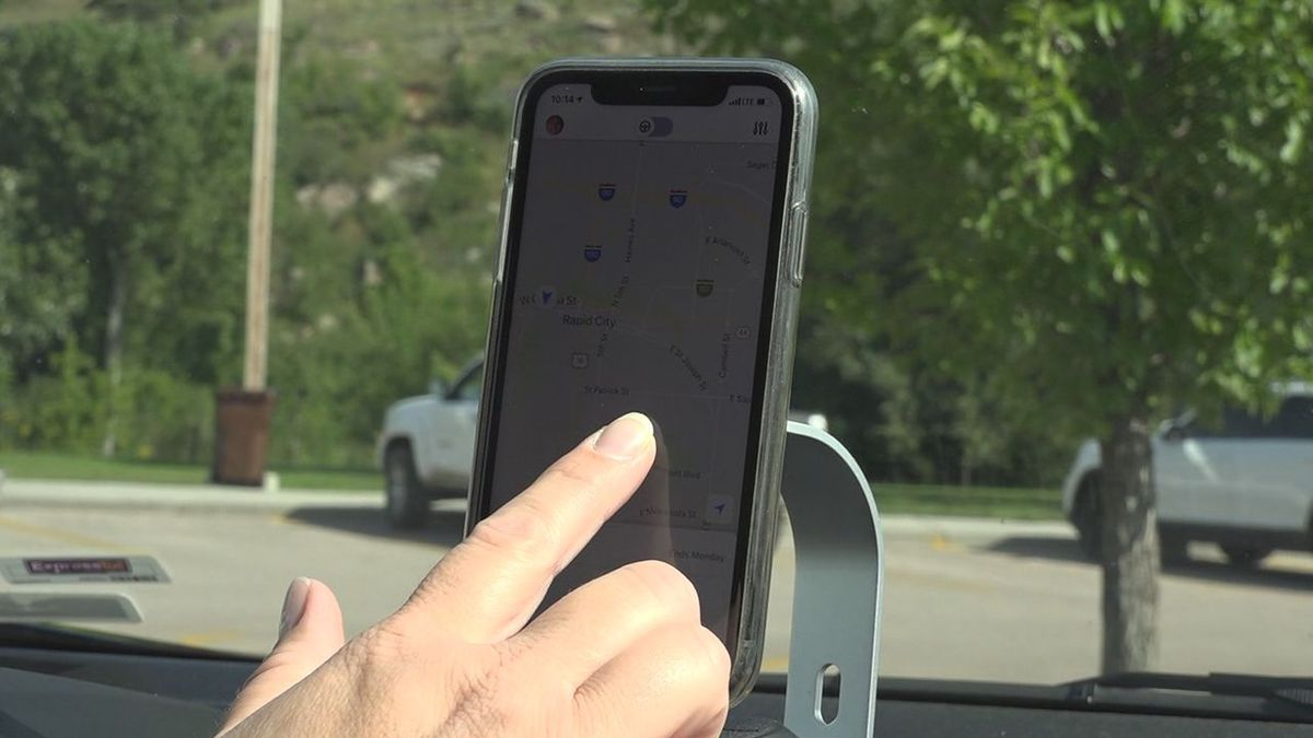 A Lyft driver is checking the app to see if she got any ride request. (KOTA)