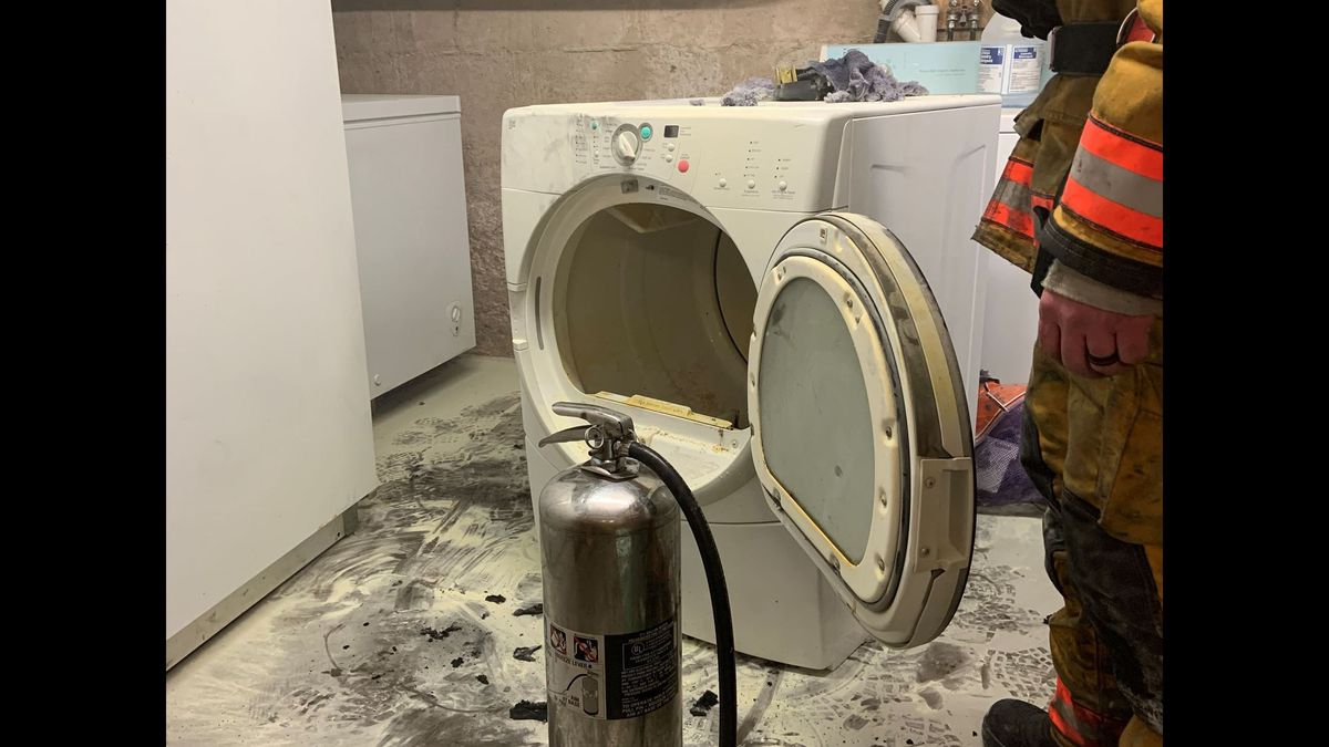 Photo caption: Pictured is the dryer that caught on fire Monday in the basement of the...