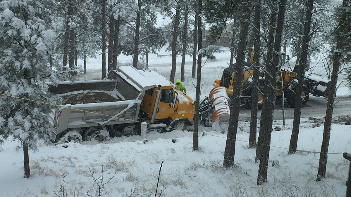 You know we are in trouble when even a snow plow has to be pulled out of the ditch. (photo by Jeanie)