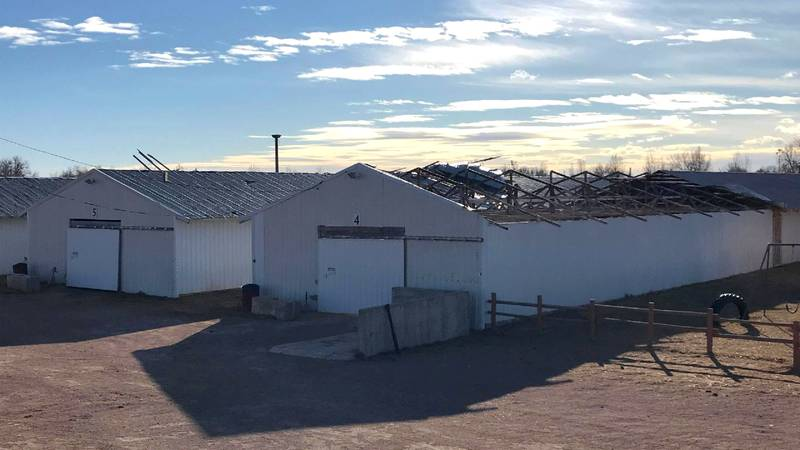 Winds ripped the metal roof off of Barn 4 at the Central States Fairgrounds in Rapid City,...