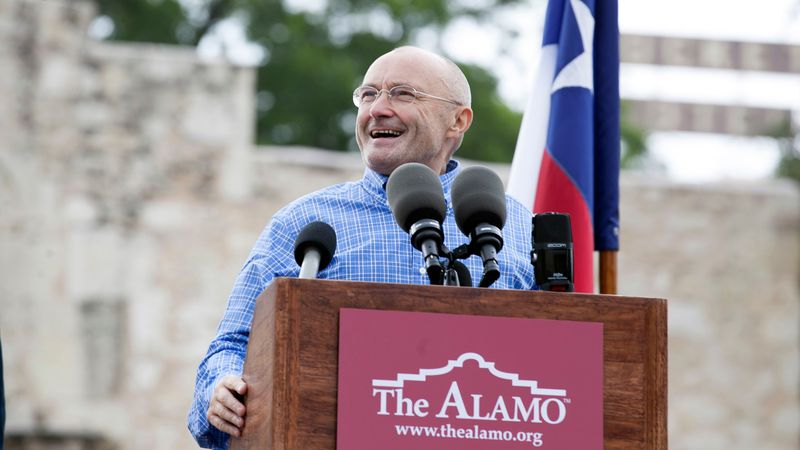 Singer Phil Collins appears in front of the Alamo to announce his donation of over 200 Texas...