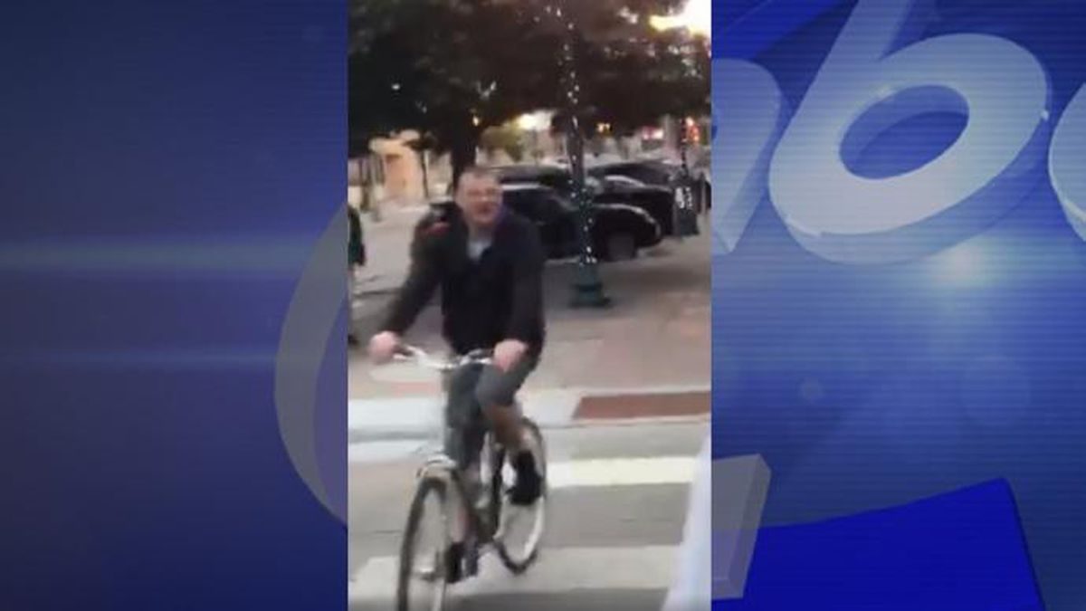 The video, shot by Jymell Nave, shows a man riding a bike and repeatedly yelling racial slurs at the group of three men. (Jymell Nave)