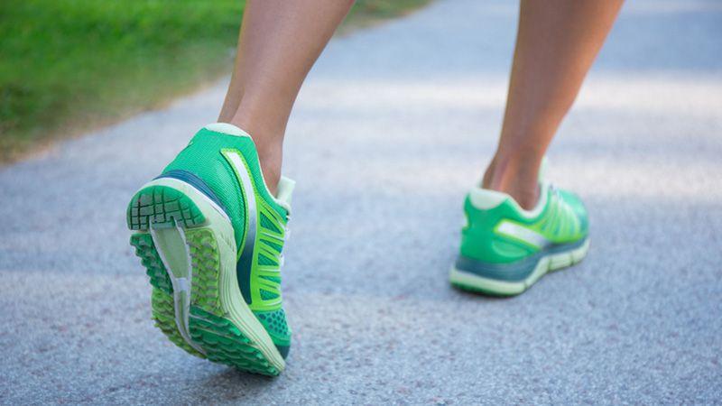 Woman walking in green shoes