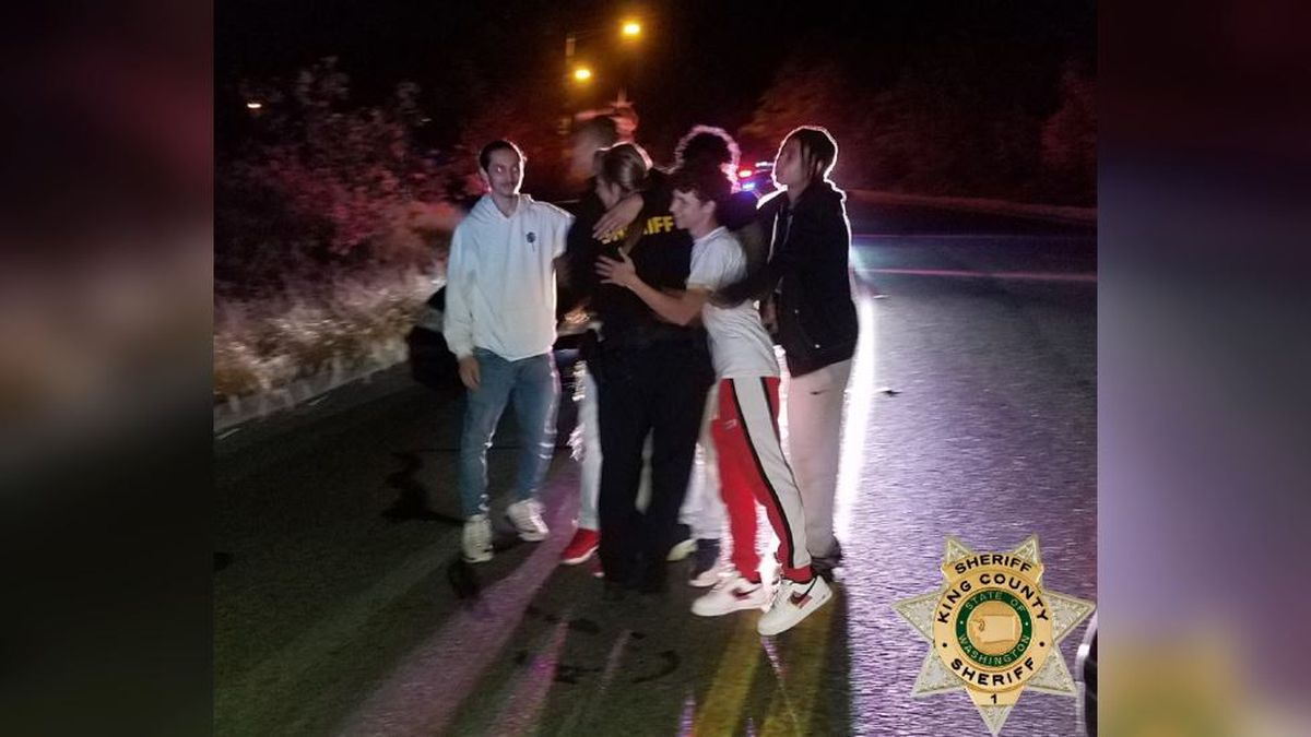 The sheriff's office says this photo was taken a few minutes after the young men helped save Deputy Elliot from a chokehold.