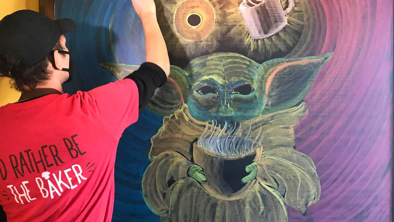 "Dan Lutz of Rapid City draws the ""dark side"" and ""light side"" around Baby Yoda from ""The..."