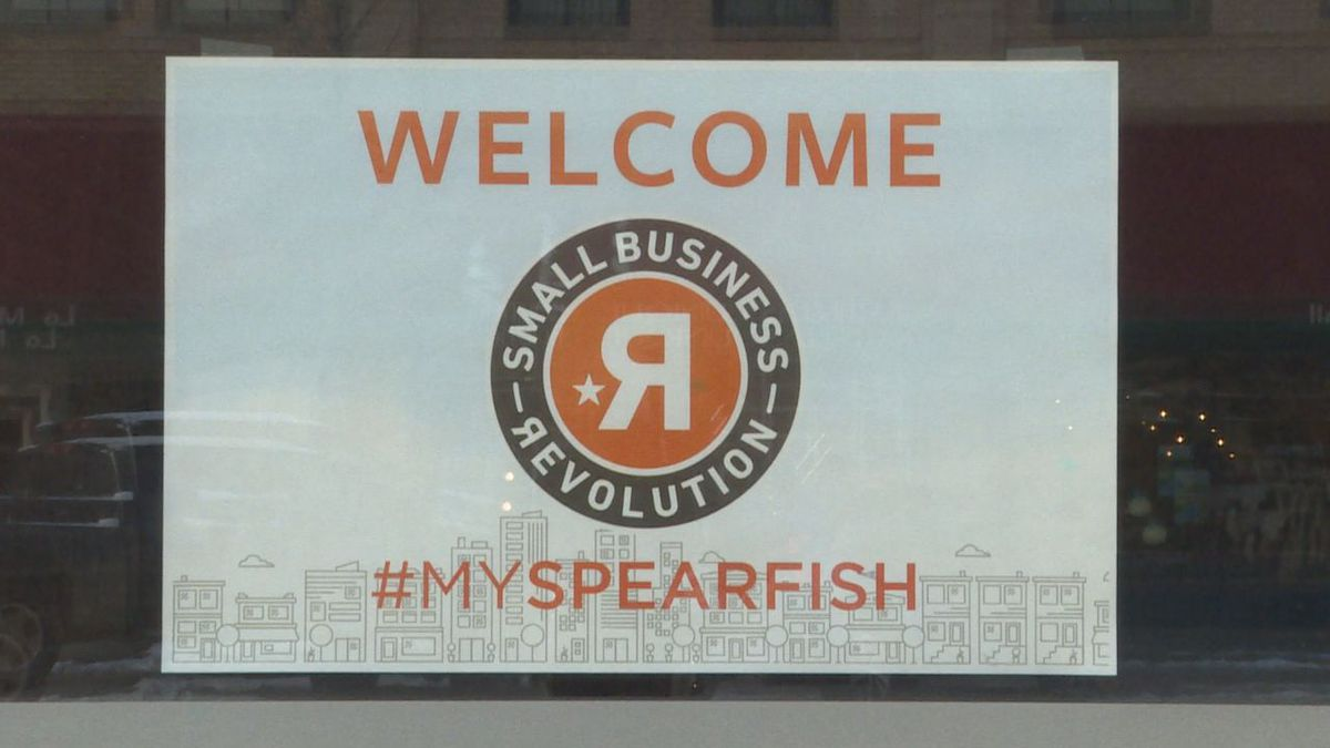 A poster hanging in the window of a local business in Spearfish.