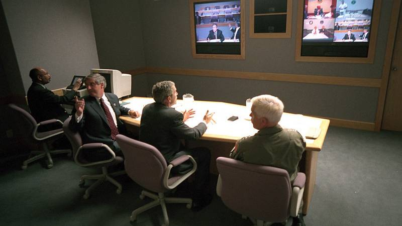 In this file photo from the U.S. National Archives, President Bush gets an update on the 9/11...