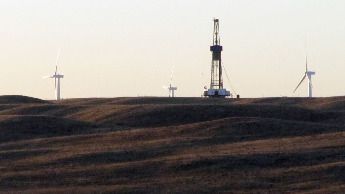 A rig drilling an oil well for QEP Resources Inc., is shown on ranch land a few miles west of Cheyenne, Wyo., Sept. 30, 2010.   (AP Photo/Mead Gruver)