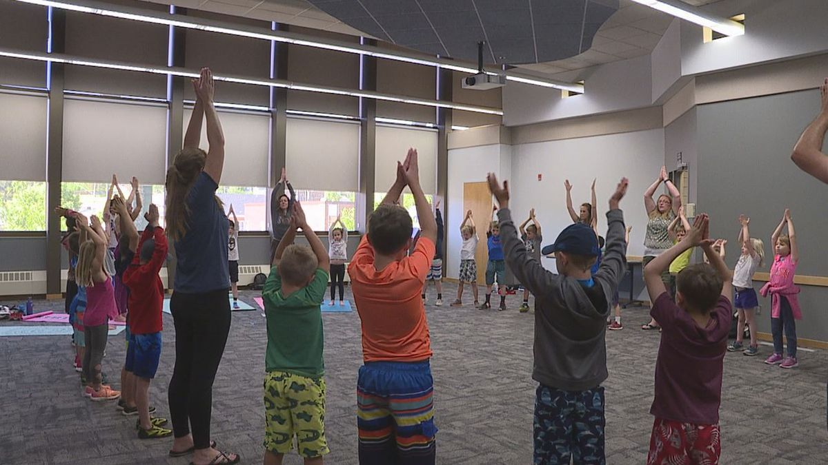 Children perform yoga poses during the Kids Yoga and Story Time event at Rapid City Public Library. (KEVN)