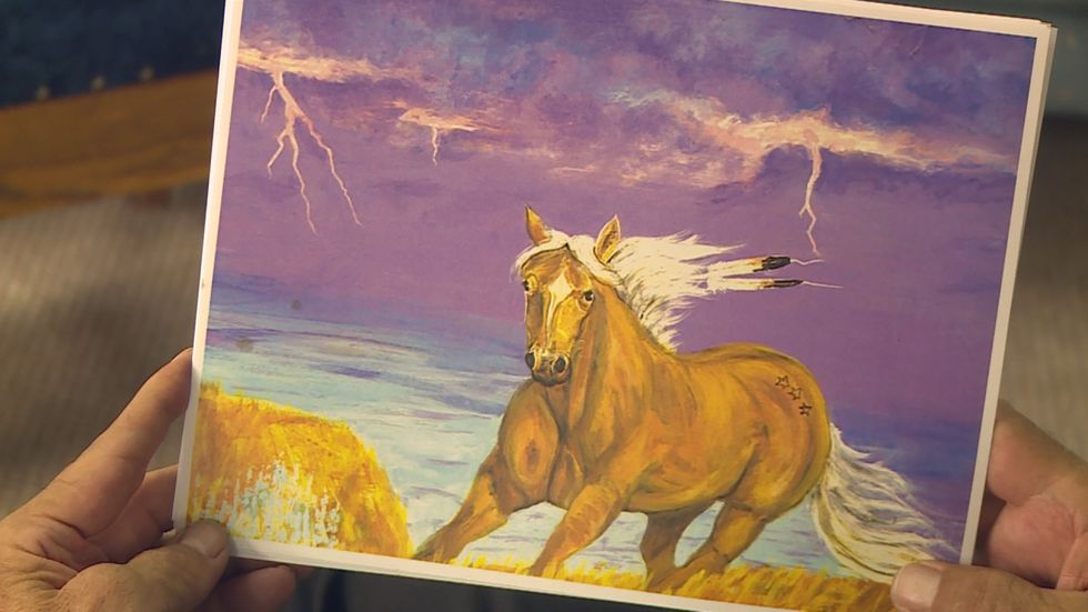 A colorful scene painted by Elton Three Stars depicts a horse running towards the viewer as...