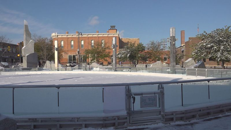 Crews are working on the ice rink.