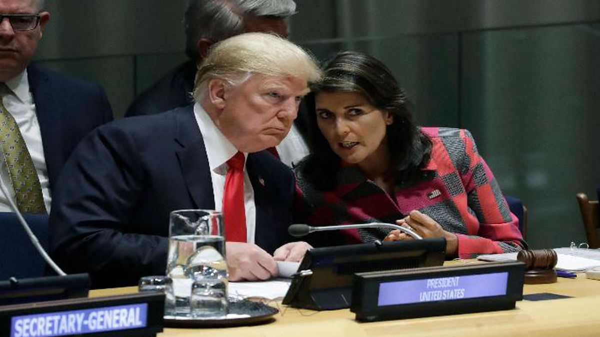 FILE- In this Sept. 24, 2018 file photo, President Donald Trump talks to Nikki Haley, the U.S. Ambassador to the United Nations, at the United Nations General Assembly at U.N. headquarters. Congressional and Trump administration officials told The Associated Press that Haley plans to resign. She was appointed to the U.N. post in November 2016. (AP Photo/Evan Vucci, File)