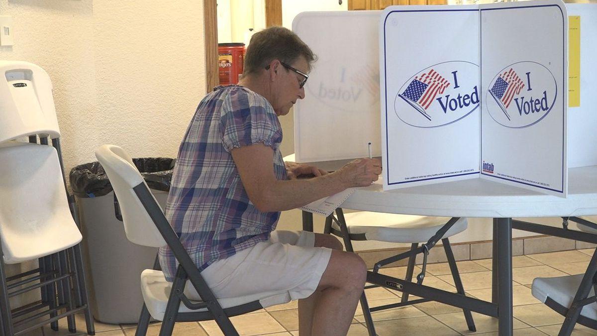 A woman fills out a ballot at Atonement Lutheran Church. (KOTA TV)
