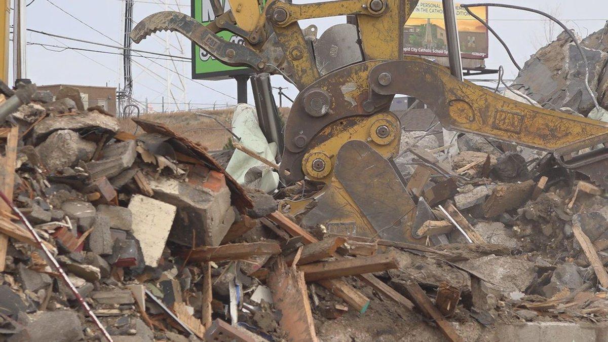 Crews are demolishing the old Hardee's building in Dakota Market Square.
