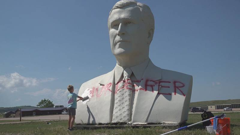 The large presidential busts of Ronald Reagan and George H. W. Bush off Highway 79 going into...