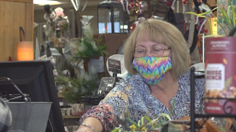 An employee at Weathered Vane in Rapid City is helping a customer.