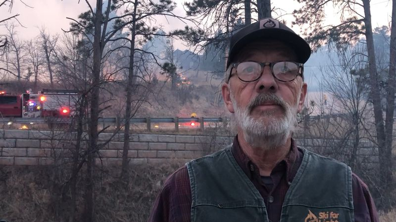 John Skulborstad awaits the fate of his home as the edge of the Schroeder Fire creeps up on his...