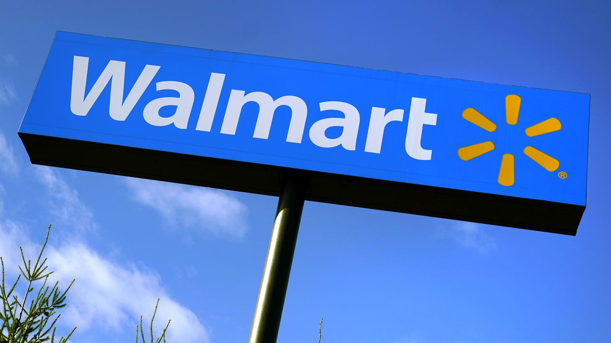 FILE - In this Nov. 18, 2020 file photo, a Walmart store sign is visible from Route 28 in...