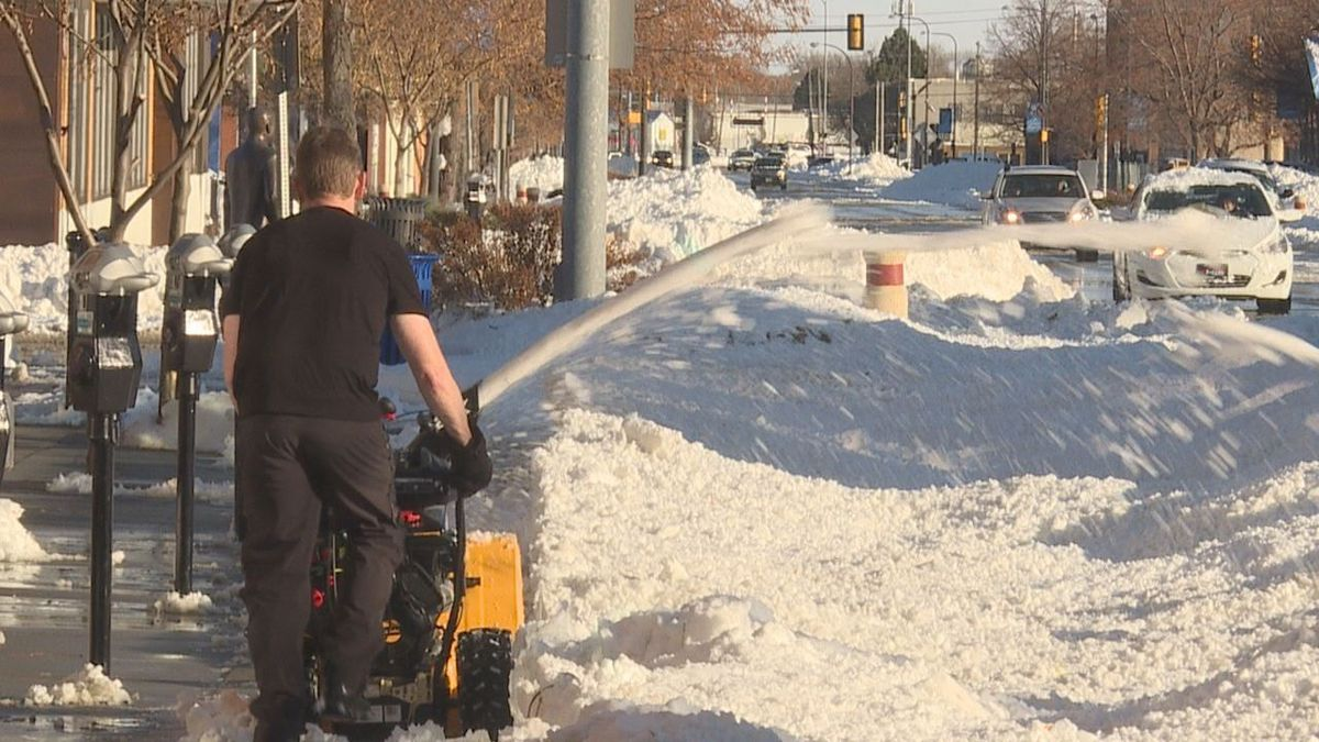 Rapid City resident plows downtown sidewalks.