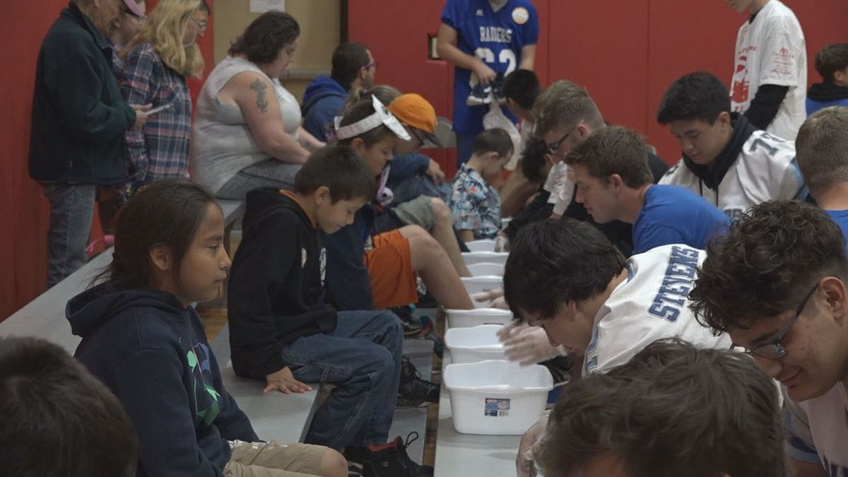 Volunteers came out to help with the sneakers and shoe giveaway. <br />(KOTA)