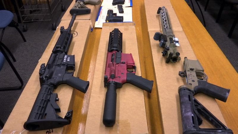 """FILE - This Nov. 27, 2019, file photo shows """"ghost guns"""" on display at the headquarters of the..."""