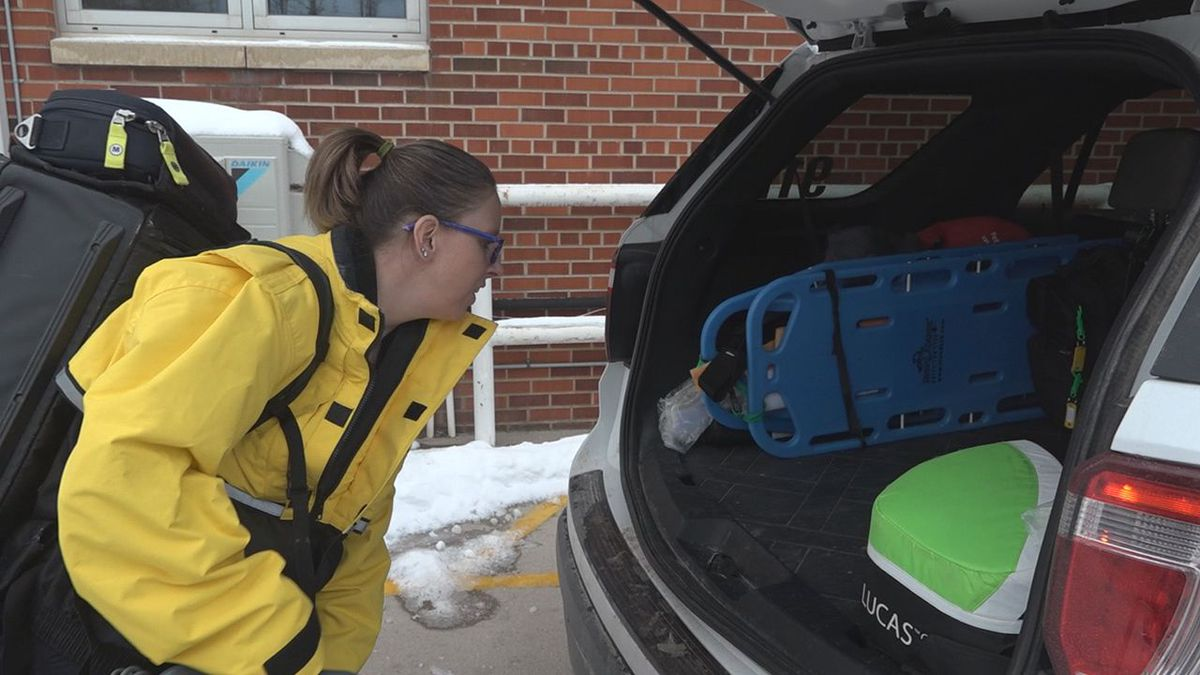 Erica Donovan is a senior paramedic and is loading the car with supplies she may need to help...