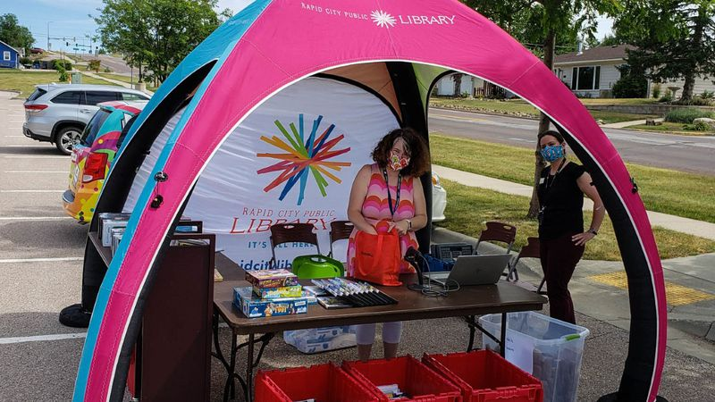 The pop-up will offer library users materials to check out, reference services, library card...