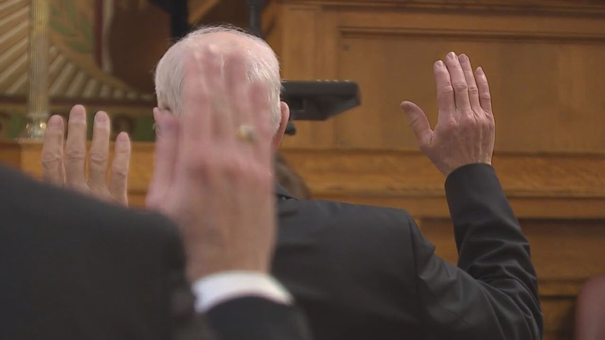 Lawmaker raises hand in oath while in Pierre, SD.