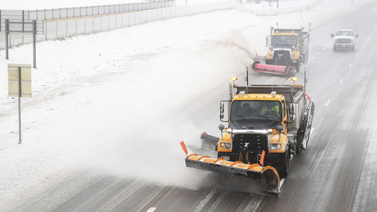Snow plows clear Interstate 29 on Thursday, April 11, in Sioux Falls, S.D. Heavy snow and...