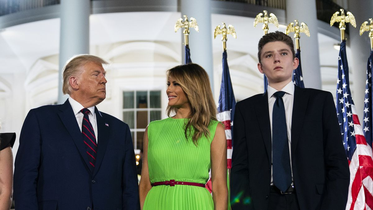 In this Aug. 27, 2020 file photo, Barron Trump right, stands with President Donald Trump and  first lady Melania Trump on the South Lawn of the White House on the fourth day of the Republican National Convention in Washington.