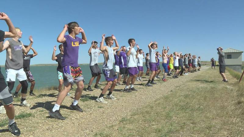 The Belle Fourche Broncs football team working out at the Orman Dam.
